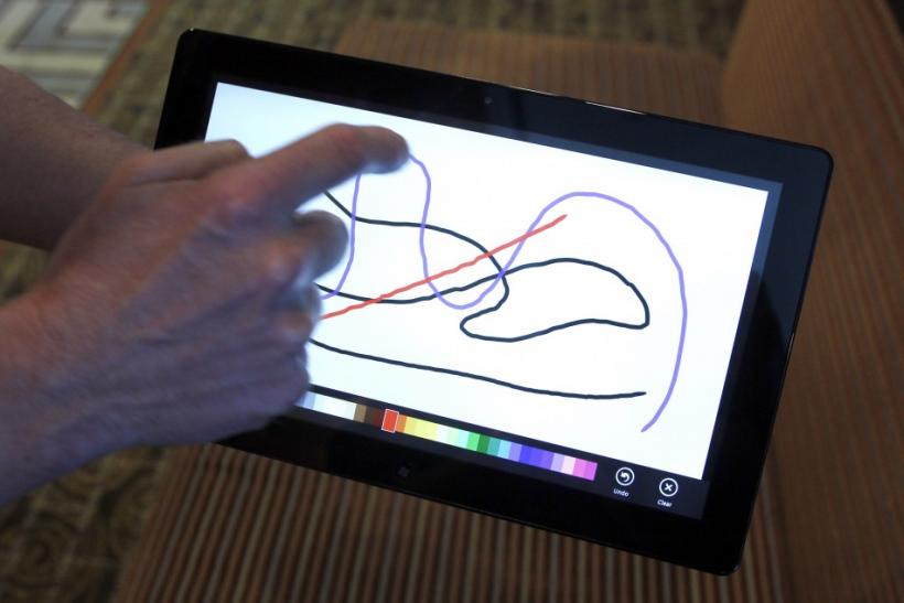 A Reuters reporter runs through a new test Microsoft Windows tablet running a version of its touch-enabled Windows 8