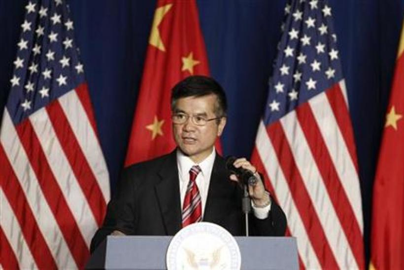 U.S. ambassador to China Gary Locke delivers a speech to the American Chamber of Commerce in the People's Republic of China and members of United States-China Business Council at the Westin Hotel in Beijing