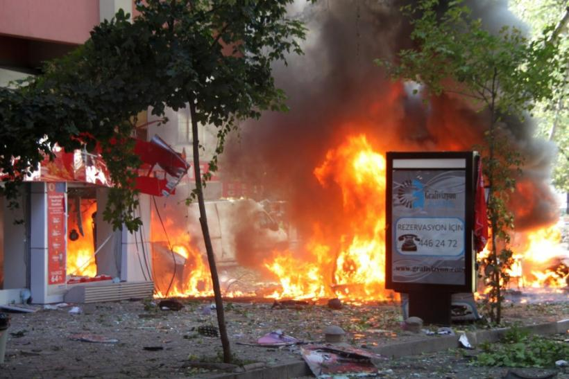 Flames are seen in a street after a blast in central Ankara