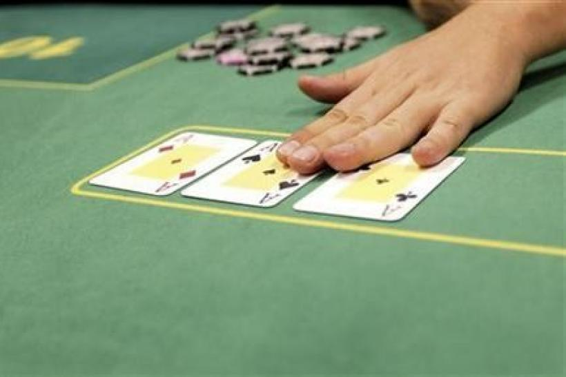 A dealer places the turn on the table in Budapest