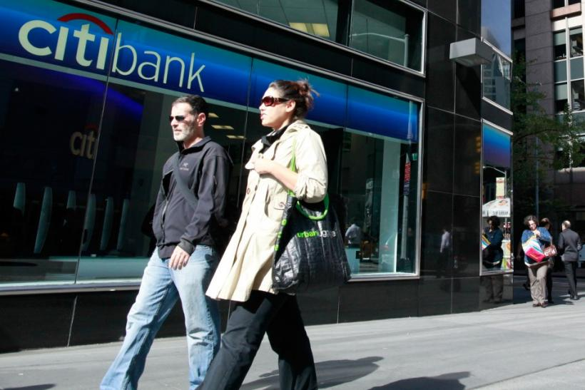 Pedestrians walk outside a bank