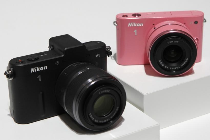 Nikon Corp's new camera Nikon 1 V1 (L) and J1 are displayed at its unveiling ceremony in Tokyo