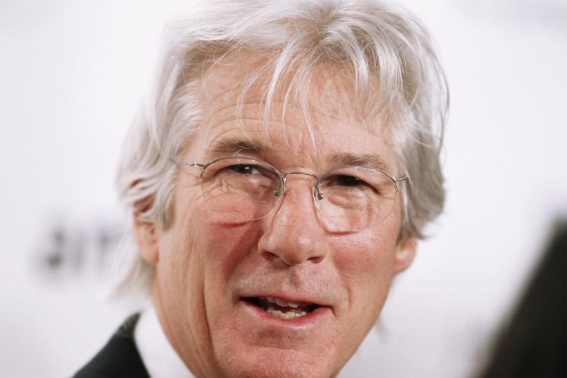Actor Richard Gere arrives to attend the amfAR New York Gala which begins Fall 2011 Fashion Week in New York