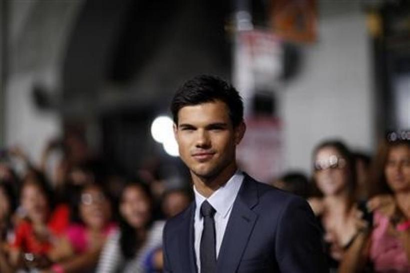 Cast member Taylor Lautner poses during the world premiere of ''Abduction'' at the Grauman's Chinese theatre in Hollywood, California