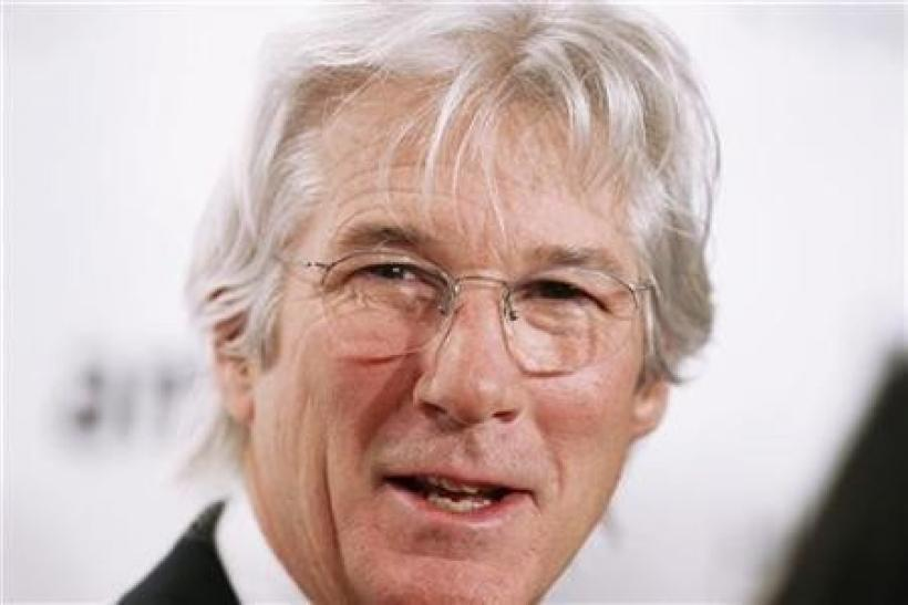 Richard Gere arrives to attend the amfAR New York Gala which begins Fall 2011 Fashion Week in New York