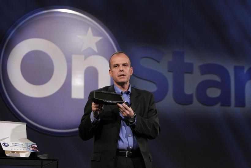 OnStar President Chris Preuss displays a standalone rearview mirrot