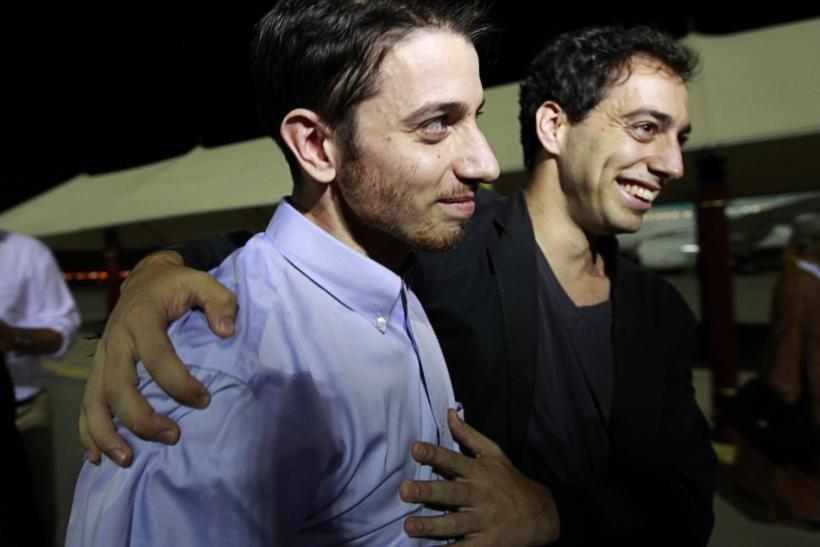 Josh Fattal, one of the U.S. hikers who was held in Iran on charges of espionage, hugs his brother Alex upon his arrival in Muscat after the release from Tehran's Evin prison