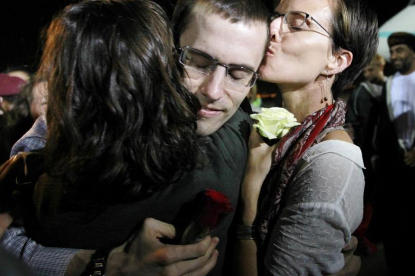 Shane Bauer, one of the U.S. hikers who was held in Iran on charges of espionage, hugs fiance Sarah Shourd during his arrival in Muscat after his release from Tehran's Evin prison