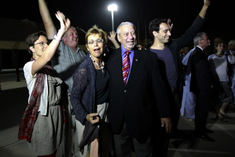 Sarah Shourd, Laura Fattal and relatives wave to Josh Fattal and Shane Bauer, U.S. hikers who were held in Iran on charges of espionage, during their arrival in Muscat, after their release from Tehran's Evin prison