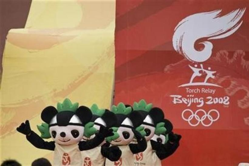 Actors dressed as Olympic ''Fuwa'' mascots perform during a ceremony for the 2008 Beijing Olympic torch relay in Beijing