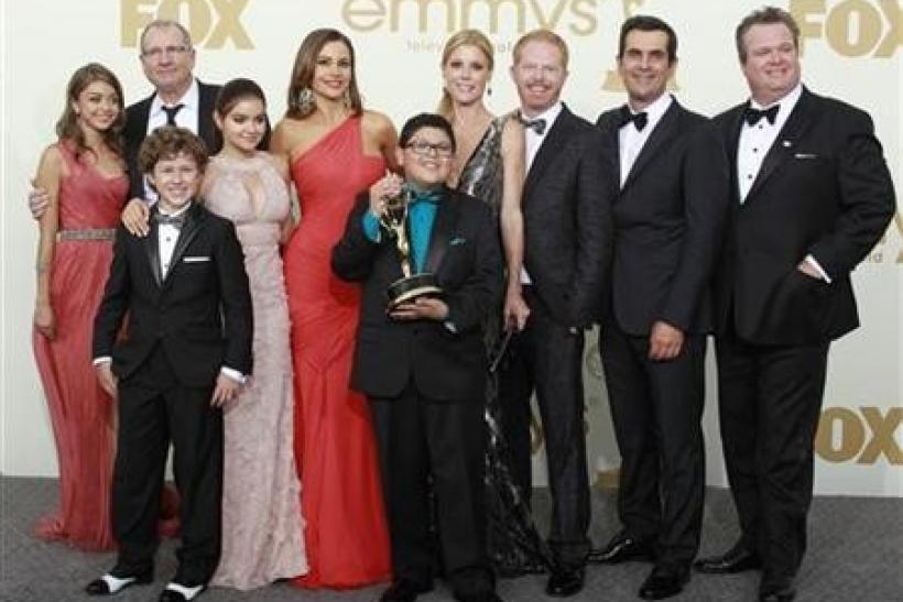 (L-R) The cast of ''Modern Family'' Sarah Hyland, Nolan Gould, Ed O'Neill, Ariel Winter, Sofia Vergara, Rico Rodriguez, Julie Bowen, Jesse Tyler Ferguson, Ty Burrell and Eric Stonestreet pose backstage after the show won for best