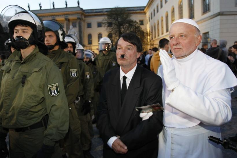 Artist opposing the visit of Pope Benedict XVI dresses like the pope during a protest in Berlin