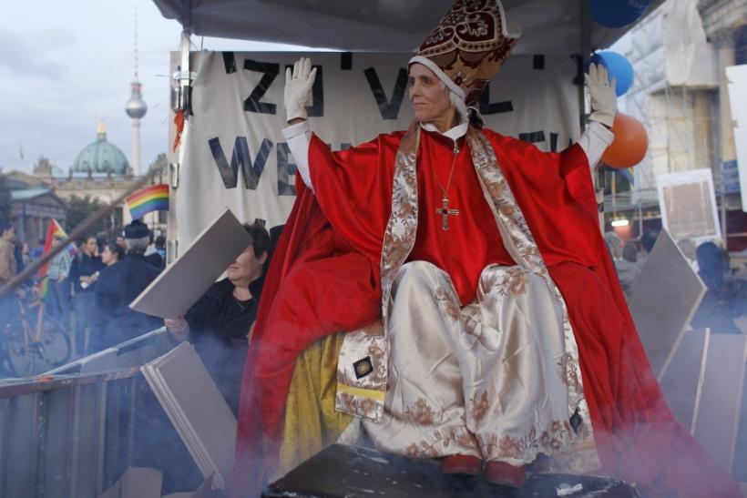 Demonstrators opposing the visit of Pope Benedict XVI hold a protest near the Brandenburg Gate in Berlin