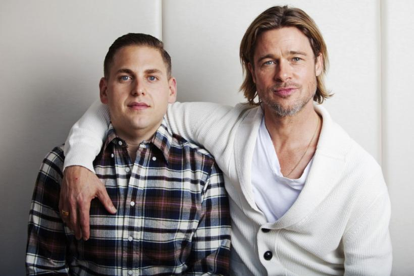 "Actors Pitt and Hill of the film ""Moneyball"" pose during the 36th Toronto International Film Festival (TIFF) in Toronto"