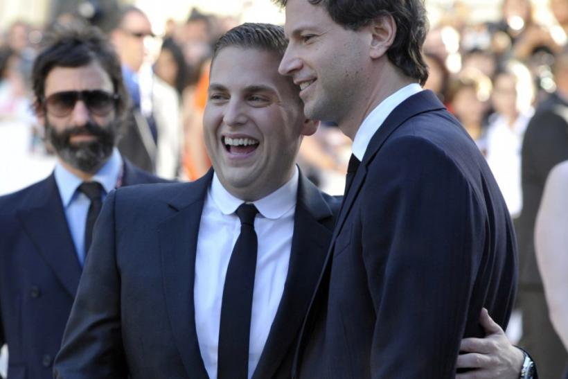 Actor Jonah Hill poses with director Bennett Miller at the gala presentation for the film 'Moneyball' at the Toronto International Film Festival