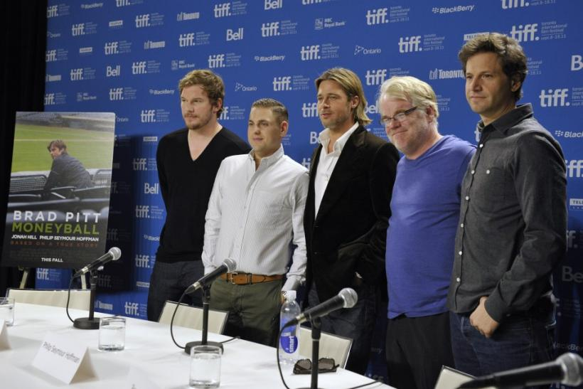 Cast members pose at the news conference for the film 'Moneyball' at the Toronto International Film Festival