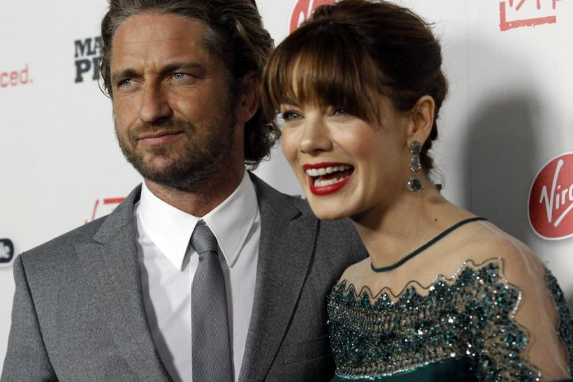"Cast members Gerard Butler and Michelle Monaghan pose at the premiere of ""Machine Gun Preacher"" at the Samuel Goldwyn theatre in Beverly Hills, California"