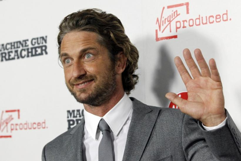 "Cast member Gerard Butler waves at the premiere of ""Machine Gun Preacher"" at the Samuel Goldwyn theatre in Beverly Hills, California"