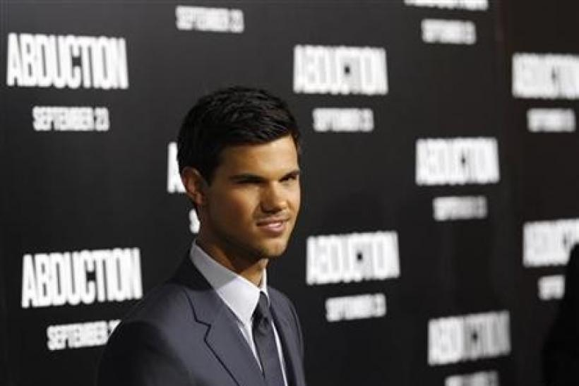 Cast member Taylor Lautner poses at the world premiere of ''Abduction'' at the Grauman's Chinese theatre in Hollywood, California September 15, 2011. The movie opens in the U.S.