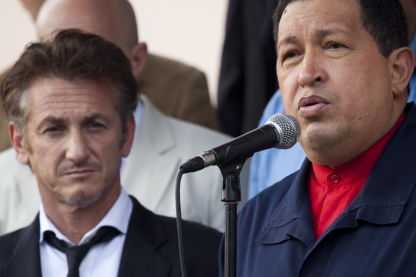 Venezuelan President Hugo Chavez speaks to the media as he stands next to the U.S. actor Sean Penn after their meeting at Miraflores Palace in Caracas
