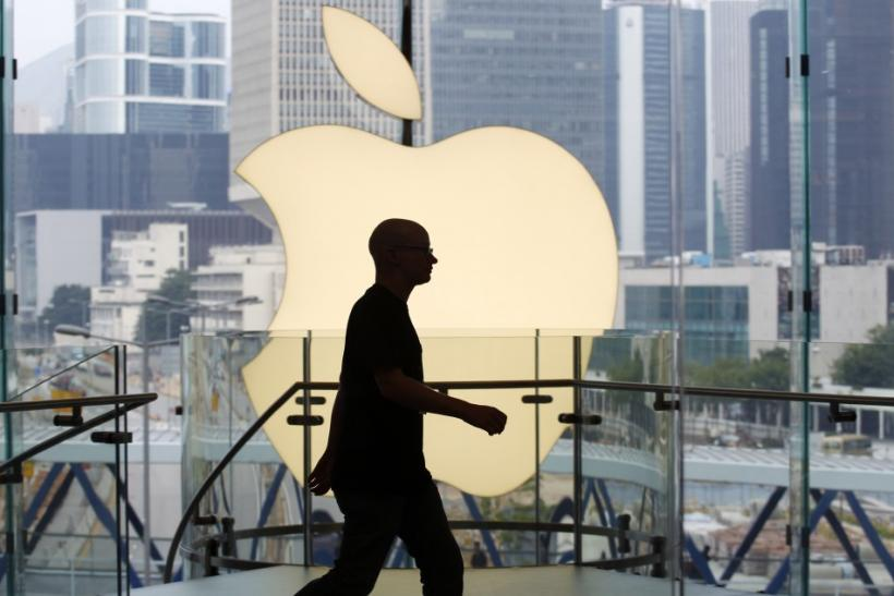 An employee walks inside Hong Kong's first Apple Store at Two IFC before its opening in the financial Central district