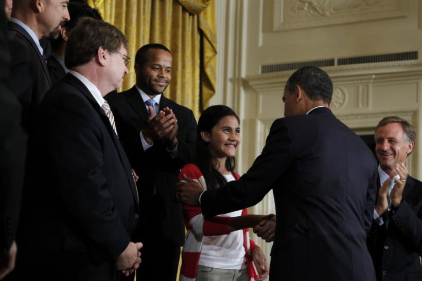 U.S. President Barack Obama greets Keiry Herrera at a No Child Left Behind event in Washington.