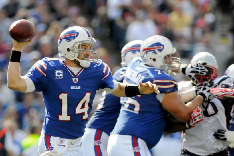 Buffalo Bills quarterback Ryan Fitzpatrick (14) is back to pass against the New England patriots, in the second quarter of their NFL football game in Orchard Park