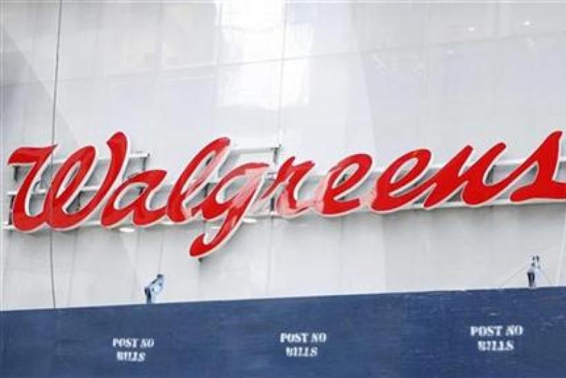 A Walgreens sign can be seen above Times Square in New York