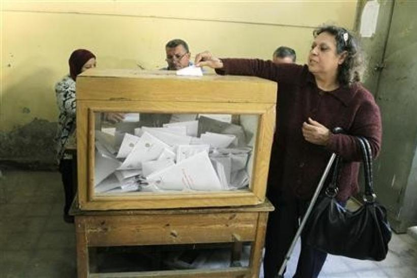 An Egyptian woman casts her vote during a national referendum at a school in Cairo