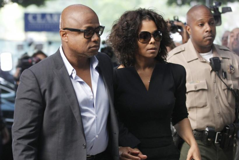 Janet Jackson arrives with her brother Randy during the opening day of Dr. Conrad Murray's trial in the death of pop star Michael Jackson in Los Angeles