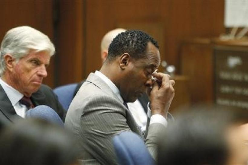 Dr. Conrad Murray (C) wipes a tear during the opening arguments in his trial in the death of pop star Michael Jackson in Los Angeles