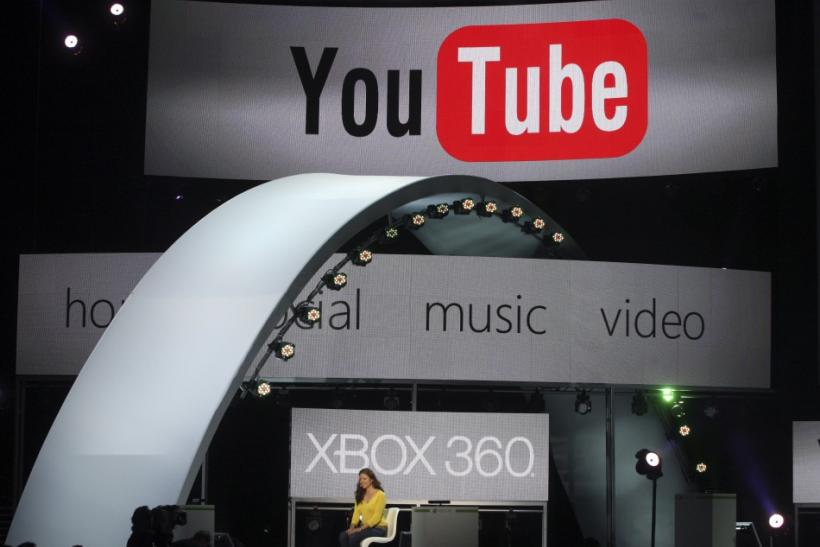 A woman demonstrates YouTube services on the Xbox game console at the Microsoft E3 XBOX 360 press briefing in Los Angeles