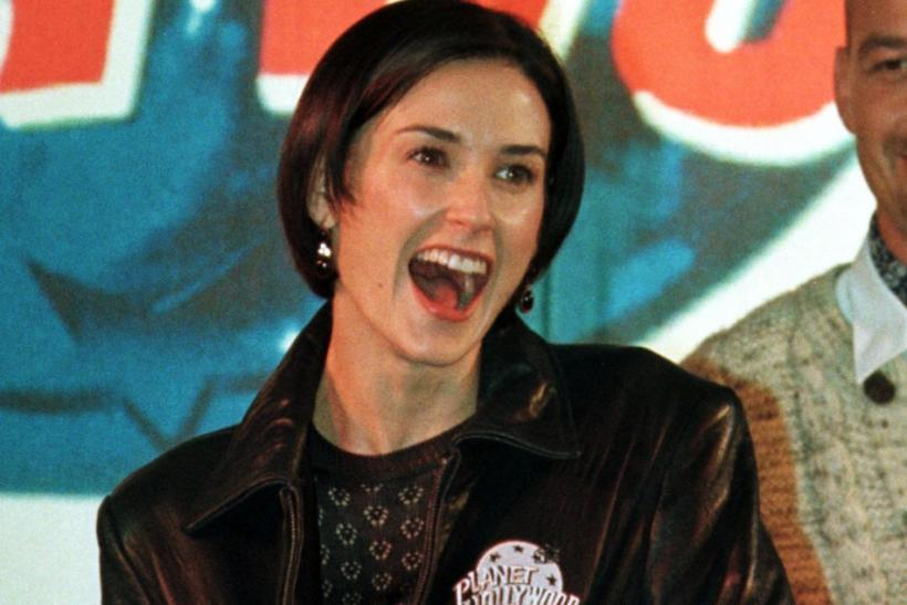 American actress Demi Moore presents a Planet Hollywood Jacket during an opening ceremony.
