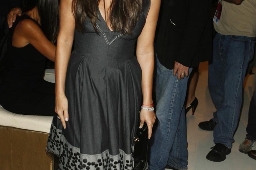 Actress Demi Moore smiles before watching the Donna Karan Spring 2008 collection show during New York Fashion Week