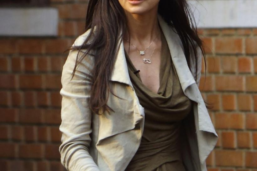 Actress Demi Moore arrives for a news conference in Kathmandu