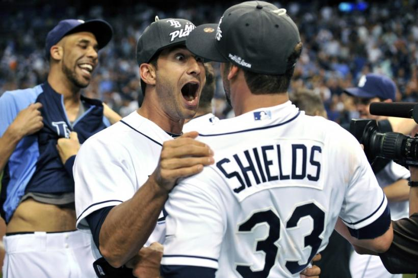 Rays' Ruggiano celebrates with teammates Price and Shields after their team defeated the Yankees in their American League MLB baseball game in St. Petersburg