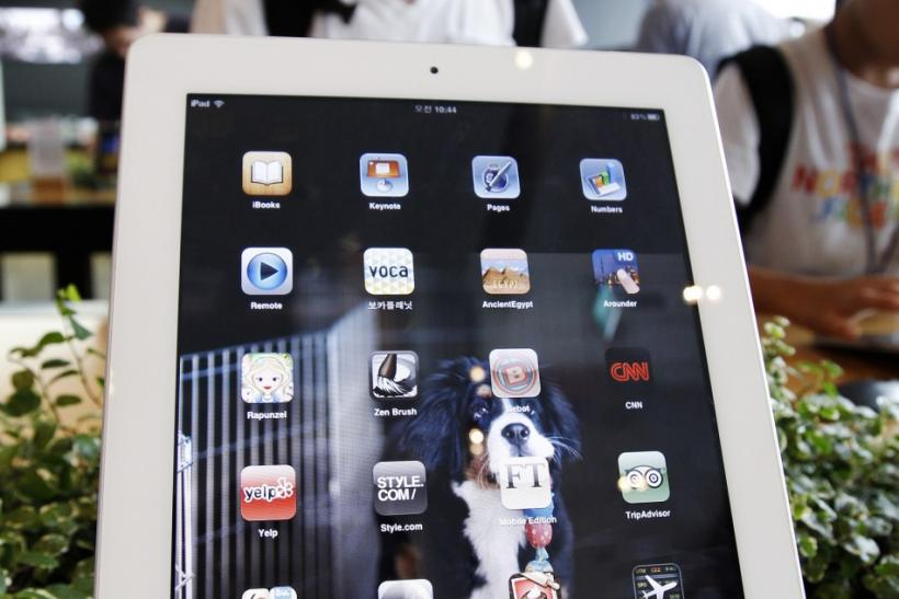 A customer looks at an Apple Inc's iPad 2 tablet at South Korean mobile carrier KT's headquarters in Seoul