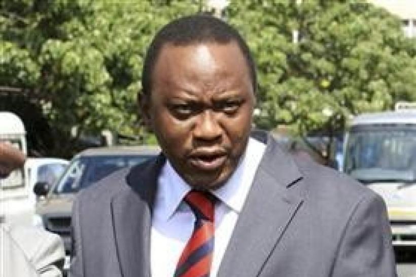 "Kenya""s Finance Minister Uhuru Kenyatta walks to Parliament"