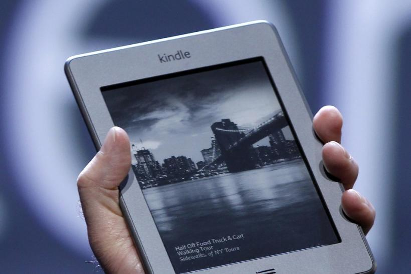 Amazon CEO Jeff Bezos holds up the new Kindle Touch. If Amazon buys Palm, the Kindle, Kindle Touch, and Kindle Fire could all run on an enhanced version of webOS.