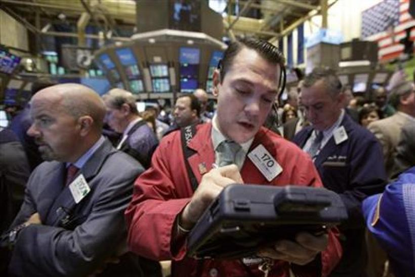 Trader Michael Zicchinolfi works on the floor of the New York Stock Exchange