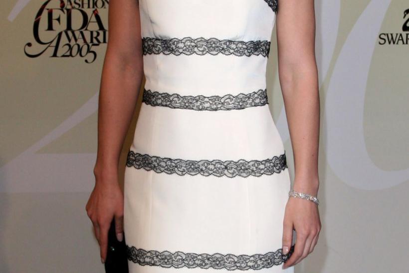 Actress Claire Danes poses for pictures at the CFDA Fashion Awards in New York.