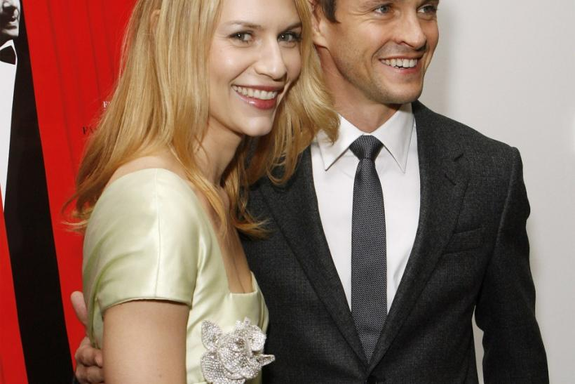 "Actress Claire Danes arrives with actor Hugh Dancy at the premiere of the film ""Valentino: The Last Emperor"" in New York"