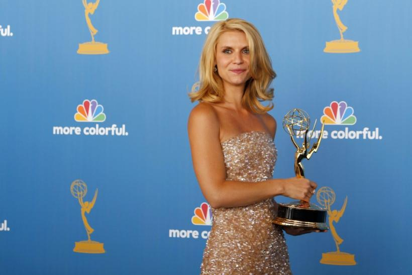 "Danes poses with her award for outstanding lead actress in a mini-series or movie for ""Temple Grandin"" at the 62nd annual Primetime Emmy Awards in Los Angeles"