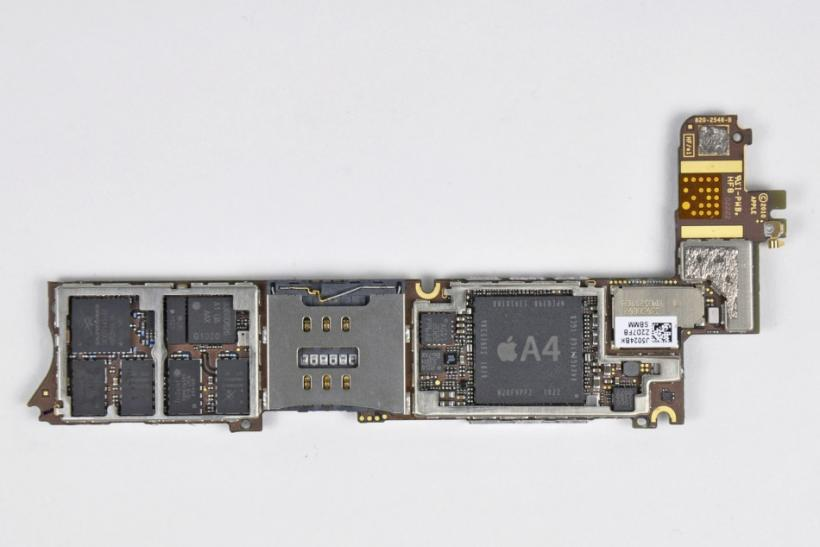 The A4 processor is displayed during iFixit's teardown of the iPhone 4 in San Luis Obispo