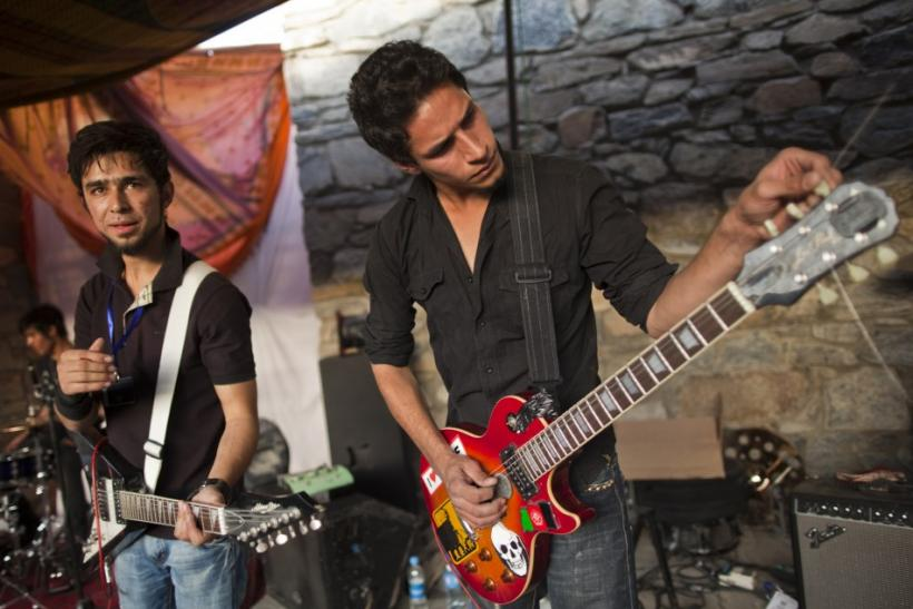 "Afghan rock artistes tune their instruments during Sound Central, a one-day ""stealth festival"" in Kabul"