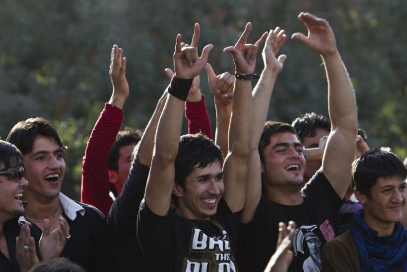"Afghans cheer during Sound Central, a one-day ""stealth festival"" in Kabul"