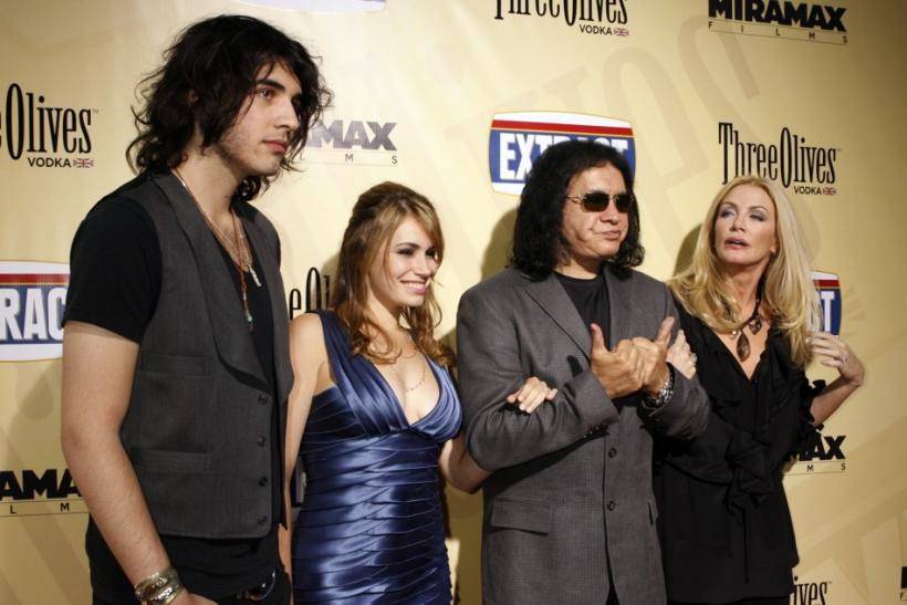 "Gene Simmons, star of the film ""Extract"", gestures as he poses at the film's premiere with his partner Shannon Tweed (R), their daughter Sophie Simmons (2nd L) and son Nick Tweed-Simmons (L) in Hollywood, California"
