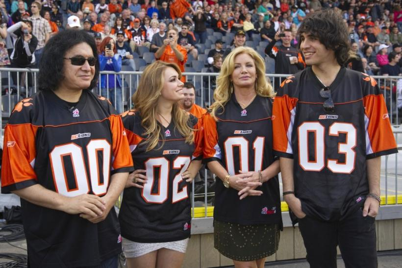 Gene Simmons of the band Kiss and his common-law spouse Shannon Tweed (2nd R) along with their children Sophie and Nick (R) stand on the sidelines before the the CFL football game between the BC Lions and Hamilton Tiger-Cats in Vancouver, British Columbia