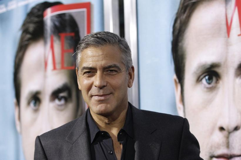 "Director and cast member George Clooney poses at the premiere of ""The Ides of March"" at the Samuel Goldwyn theatre in Beverly Hills, California"