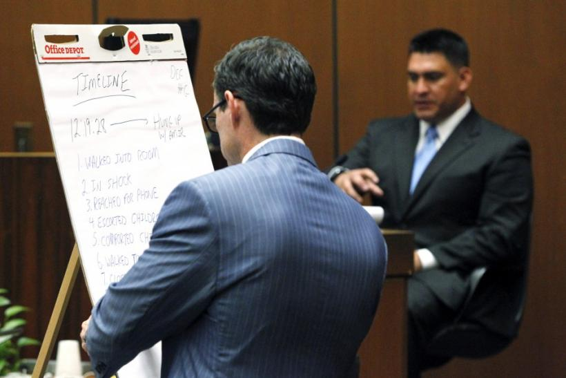 Deputy District Attorney David Walgren (L) questions Alberto Alvarez, one of Michael Jackson's security guards, about the timeline the night Michael Jackson died during Dr. Conrad Murray's trial in the death of Jackson in Los Angeles
